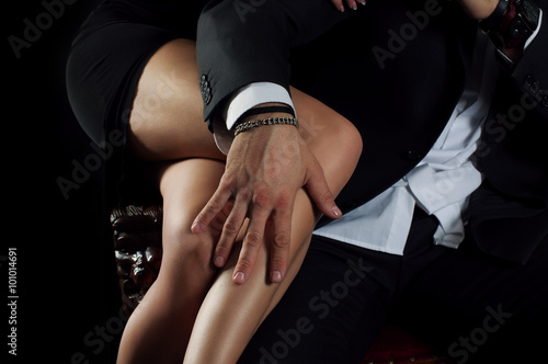 men's hand rests on the beautiful female legs Canvas Print