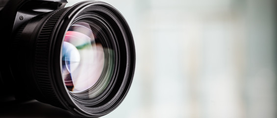 Fototapeta Close-up of a digital camera. Large copyspace