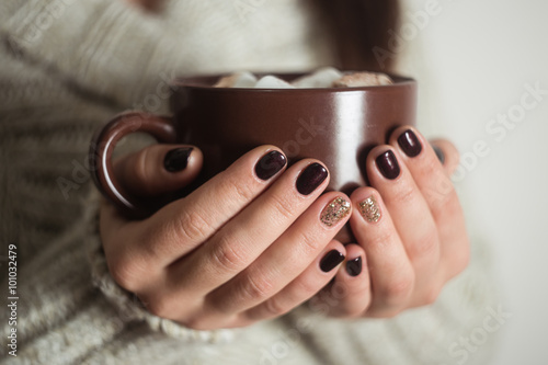 Poster Chocolate Brown cup with cocoa and marshmallow in the hands of the girl. M