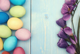 Branch of lilac flower and colorful easter eggs