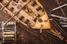 Wooden Model Ship On A Brown Table
