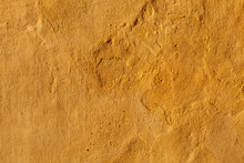 Yellow Stucco Wall. Background Texture