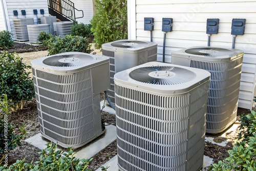 Fotografia, Obraz  Group of Air Conditioning Units At Apartment Complex