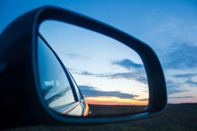 Blue Landscape Sunset Reflect In Mirror Of Car