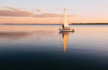 Sailing Boat On A Calm Lake Wi...