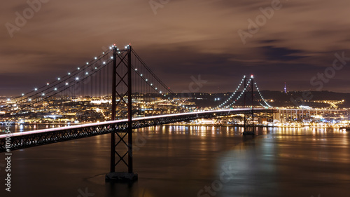 Staande foto Brug Night view of Lisbon and 25th of April Bridge, Portugal
