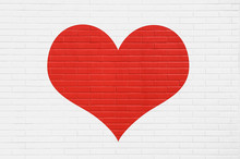 Red Heart On A White Brick Wall. Background, Love Concept.