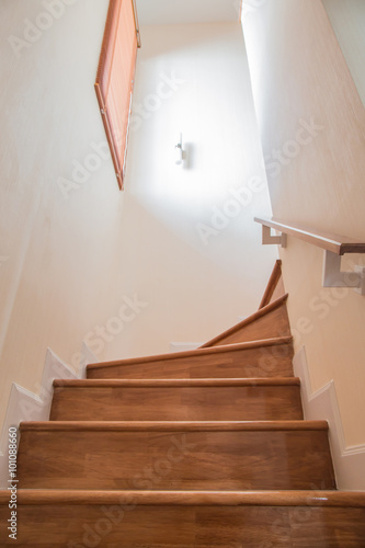 Photo Stands Stairs The catch railing and light that shines through the window of a
