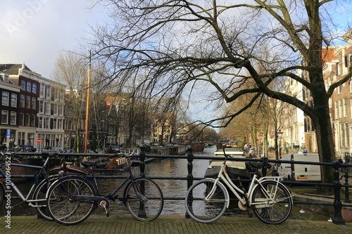 Bicycles lining a bridge over the canals of Amsterdam, Netherlands #101096452