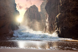 Fototapeta See - Fantastic big rocks and ocean waves at sundown time. Dramatic