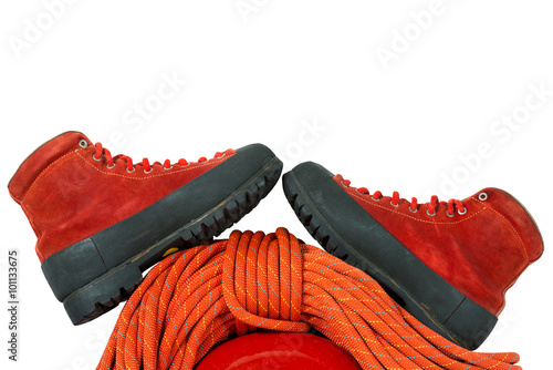 Foto op Plexiglas Alpinisme Mountaineering Boots and Rope / Detail of a rock climbing equipment with a pair of mountaineering boots, red rope and helmet. Isolated on white background