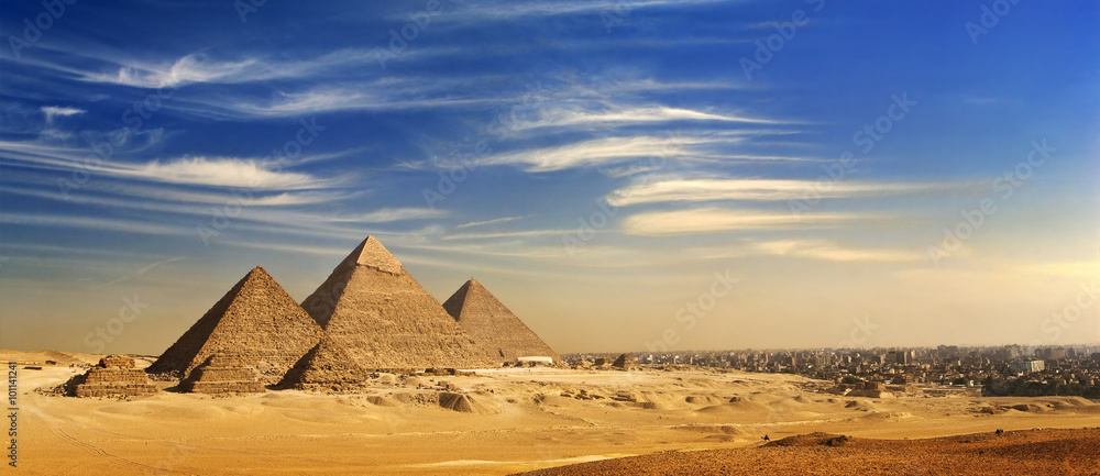 Fototapeta Egypt. Cairo - Giza. General view of pyramids and cityscape from the Giza Plateau (on front side: 3 pyramids popularly known as Queens' Pyramids; next: the Pyramid of Mykerinos, Chephren and Cheops)