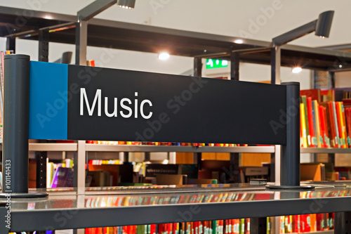 Recess Fitting Music store Music section sign inside a modern public library