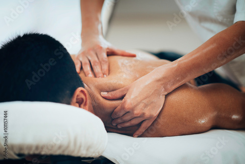 Sports massage. Therapist massaging shoulders Poster