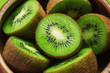 canvas print picture - Juicy ripe kiwi fruit in wooden bowl