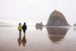 Caucasian children walking on beach, Cannon Beach, Oregon, United States