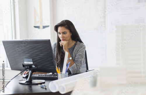 Hispanic businesswoman working in office