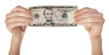 Hands Holding Five Dollar Bank...