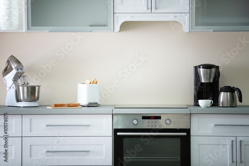 Toaster with coffee maker and mixer on a light kitchen table