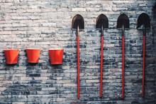 Three Fire Buckets And Shovels