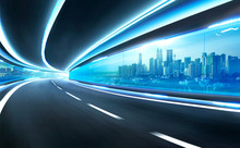Abstract Blurred Speed Motion Road In Glass Tunnel Over The City