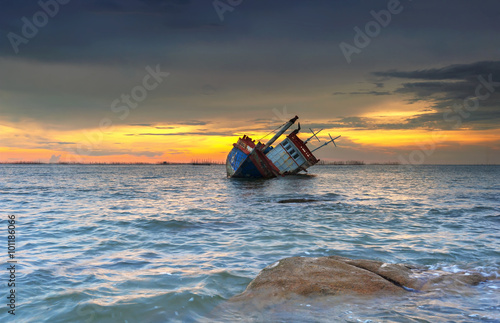Tuinposter Schipbreuk ship wrecked at sunset in Chonburi ,Thailand