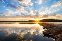 Rock Jetty Sunrise At A Lake O...