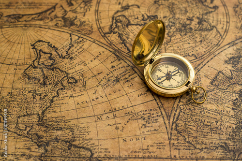 Photo  old compass on vintage map