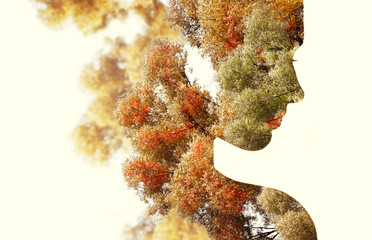 Plakat Double exposure portrait of young woman and autumn trees.