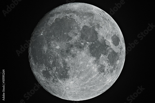 Growing big moon taken with telescope in black background. Wallpaper Mural