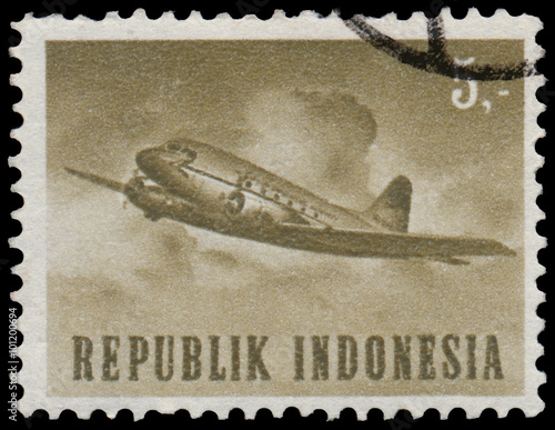 Fotografía  Stamp printed in Indonesia shows plane