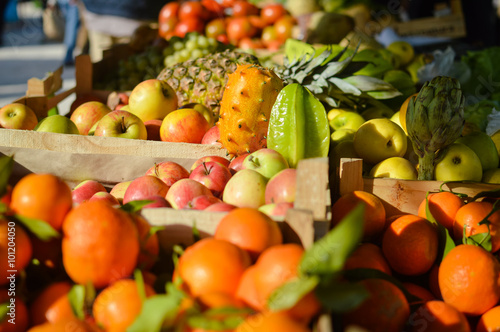 Buying And Selling Many Different Fruits At Farmers Market