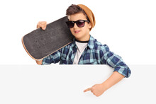 Cool Skater Boy Pointing On A Blank Panel