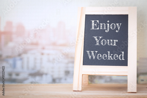 Fotografía  Concept Enjoy The Weekend message on wood boards