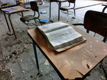 Old School Classroom In Abandoned School With Book On Desk - Landscape Photo