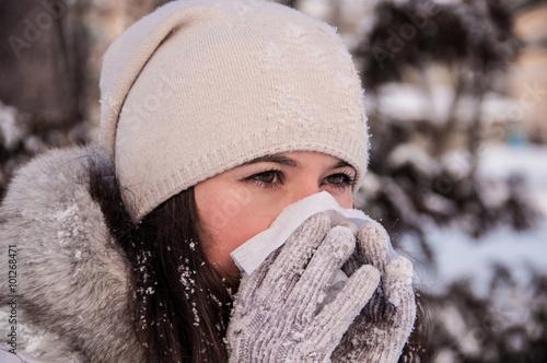 Valokuva  Girl with handkerchief has the flu and running nose winter