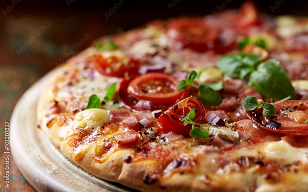 Pizza with prosciutto, cherry tomatoes and mozzarella