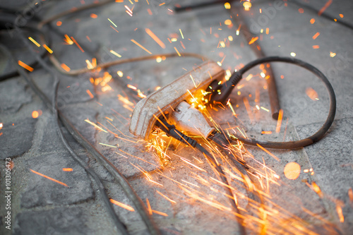 Valokuva  burning electrical outlet shorting, danger