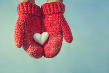 Female Hands In Knitted Mittens With A Vintage Romantic Red Hear