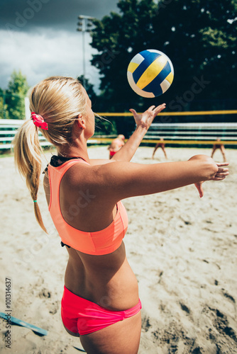 fototapeta na ścianę Beach volleyball girl serving