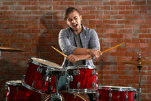 Musician Playing The Drums On ...