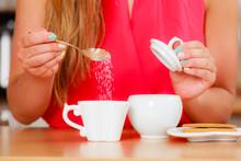 Human Adding Sugar To Tea Or Coffee.