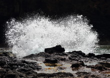 Wave Crashing On Rocks And Splashing Foam