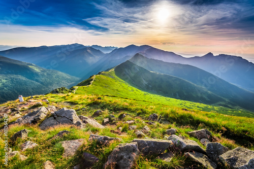 obraz dibond Wonderful sunset in mountains in summer