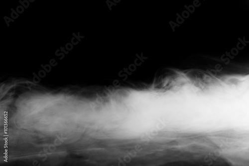 Abstract fog or smoke move on black color background Wallpaper Mural