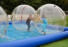 Kids Having Fun Inside Air Bubbles On The Water