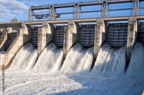 Water rushing out of opened gates of a hydro electric power dam Fototapet