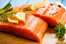 Fresh Raw Salmon Fillets On Cu...