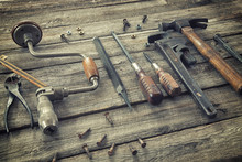 Old Tools On Rough Wood Surface