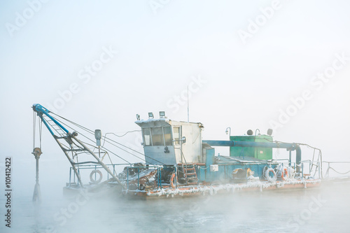 funny boat in the fog Tableau sur Toile